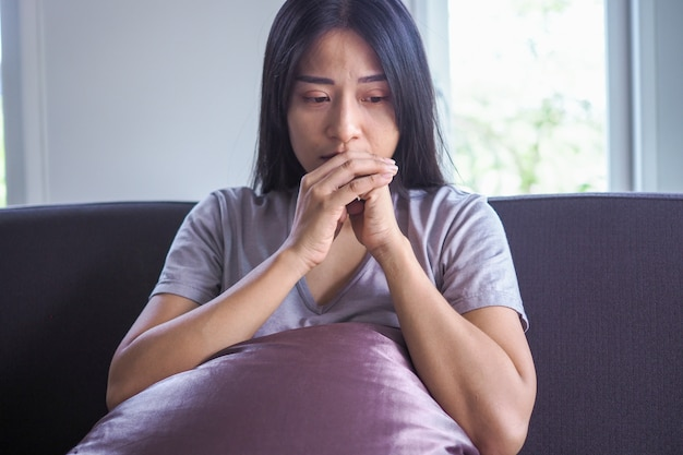 Asian woman is heartbroken after being abandoned by boyfriend and having mental illness Premium Photo