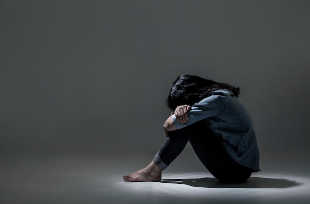 An asian woman is suffering from depression. Premium Photo