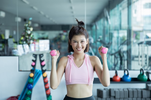 Asian woman play fitness in the gym Free Photo
