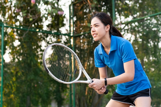 Premium Photo | Asian woman playing tennis at outdoor court