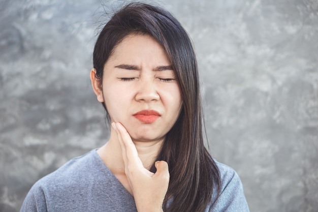 Asian woman suffering from gum pain Premium Photo
