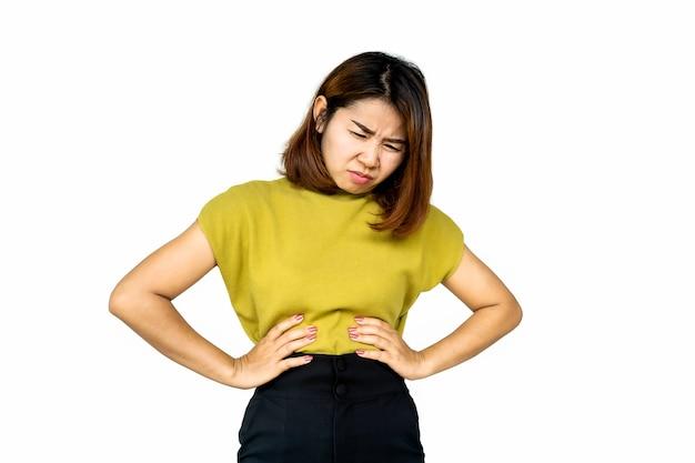 Asian woman suffering from stomach ache, heartburn Premium Photo