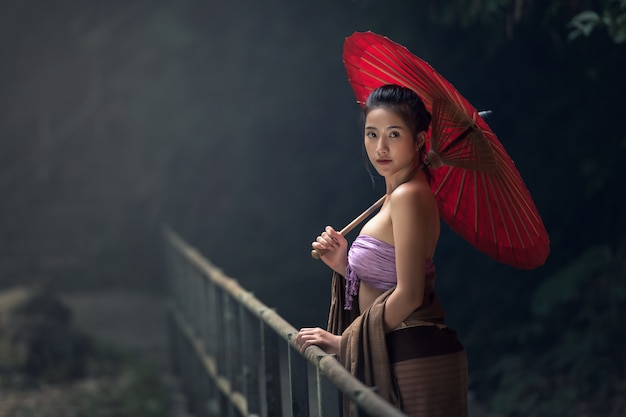 Asian woman in traditional costume, thailand Premium Photo