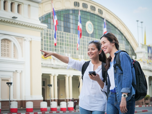 Asian woman traveling with mobile phone Premium Photo
