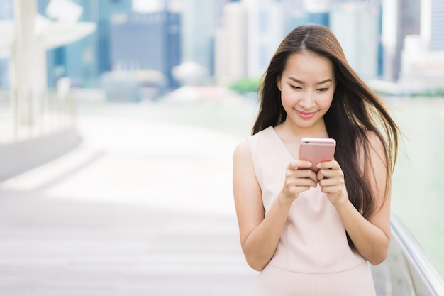 Asian woman using smartphone Free Photo