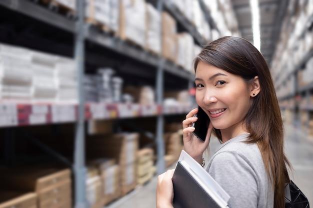 Asian woman in warehouse Premium Photo
