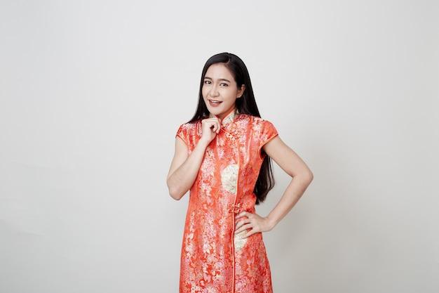 Asian woman wear cheongsam in chinese new year Premium Photo