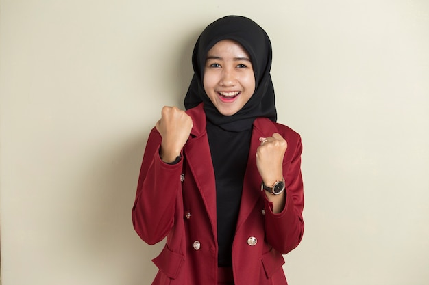 Asian woman wearing hijab happy and excited celebrating victory expressing big success, power, energy and positive emotions. celebrates new job joyful Premium Photo