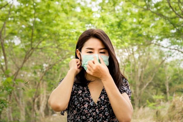 Asian woman wearing protective masks walking outdoors Premium Photo