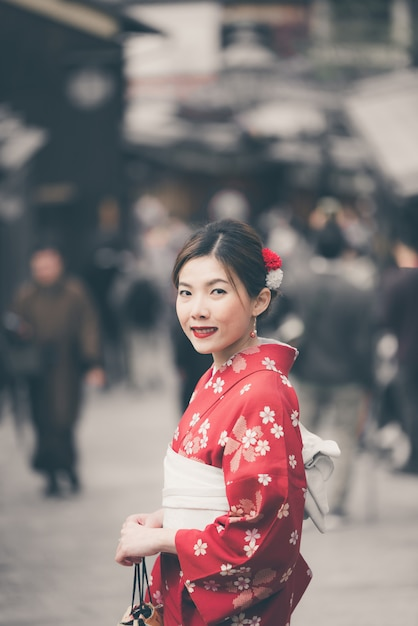 Asian woman wearing traditional japanese kimono walking in the old town of kyoto Premium Photo