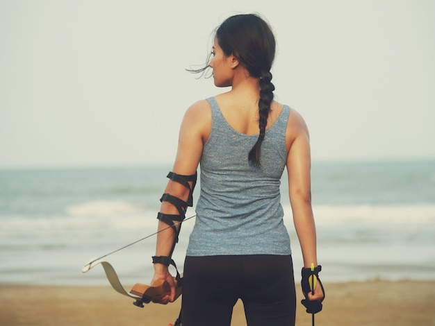 Asian woman with bow arachery Premium Photo