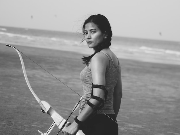 Asian woman with bow archery Premium Photo
