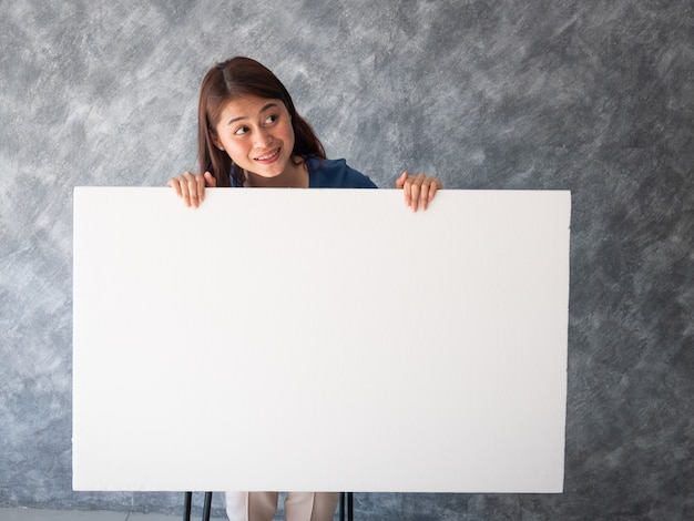 Asian woman with white banner copy space Premium Photo