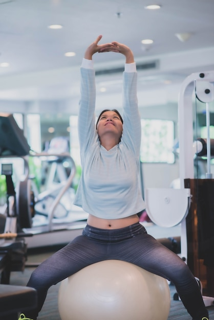 Asian woman work out exercise at gym weight loss Premium Photo