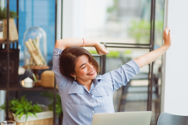 Asian woman working in cafe and  have problem with office syndrome Premium Photo