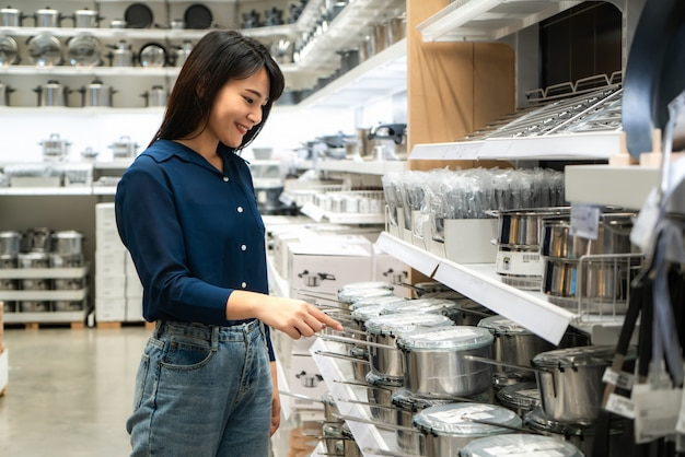 Premium Photo Asian Women Are Choosing To Buy New Kitchenware In The Mall Shopping For Groceries And Housewares