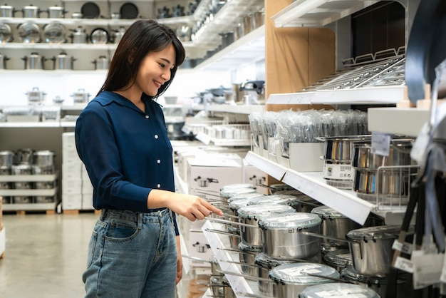 Asian women are choosing to buy new kitchenware in the mall Premium Photo