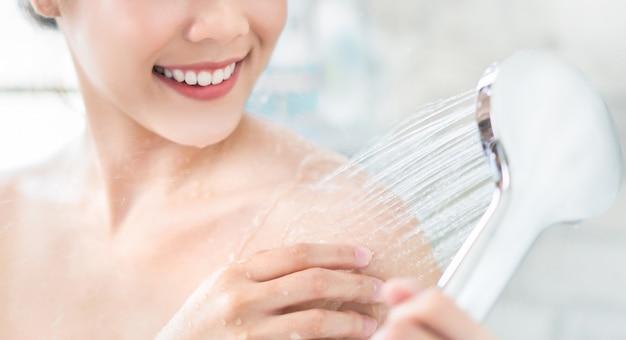 Asian women are using shower Premium Photo