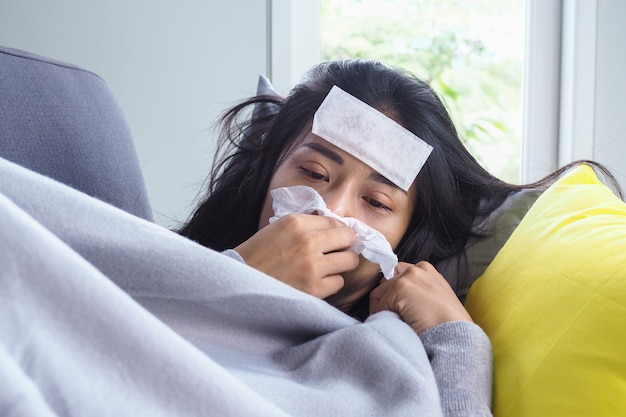 Premium Photo | Asian women have high fever and runny nose. sick people  concept