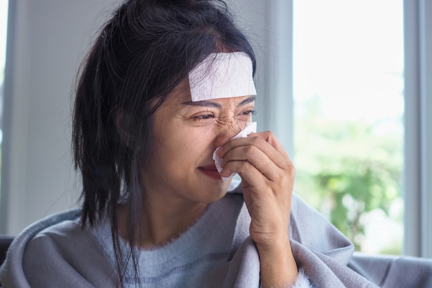 Premium Photo | Asian women have high fever and runny nose. sick people