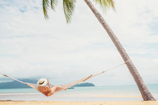 Asian women relaxing in hammock summer holiday on beach Premium Photo