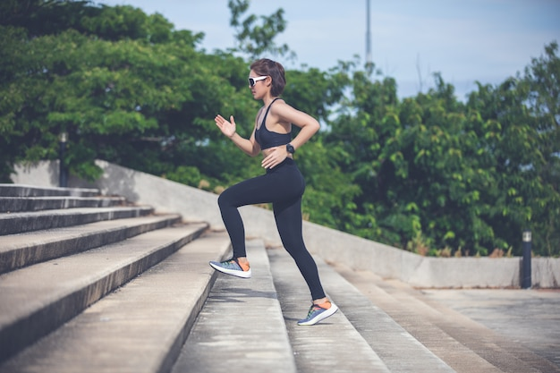 Asian women running and jogging during outdoor on city run Premium Photo