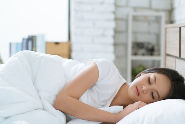 Asian women sleeping happily and dreaming.morning Premium Photo