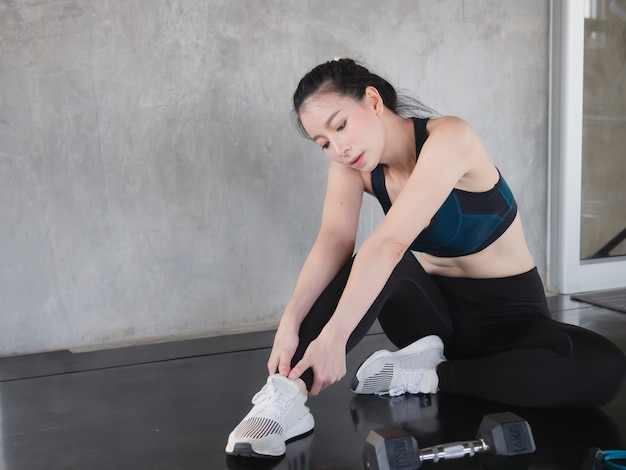 Asian women stretch before exercise,fitness concept | Premium Photo