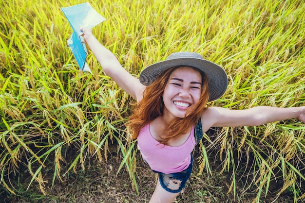 Asian women travel relax in the holiday. expand survey map mountain field. thailand Premium Photo