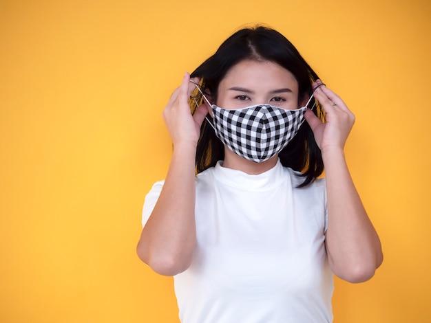 Asian women wearing mask over yellow background | Premium Photo