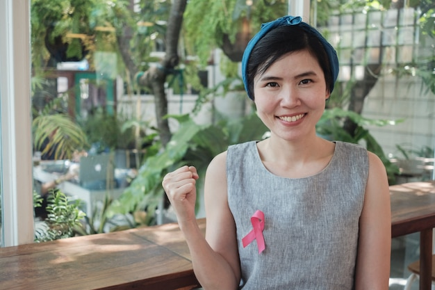 Asian women with pink ribbon, breast cancer awareness Premium Photo