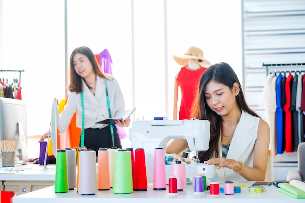 Asian Women At Work Are Fashion Designers And Tailors Premium Photo