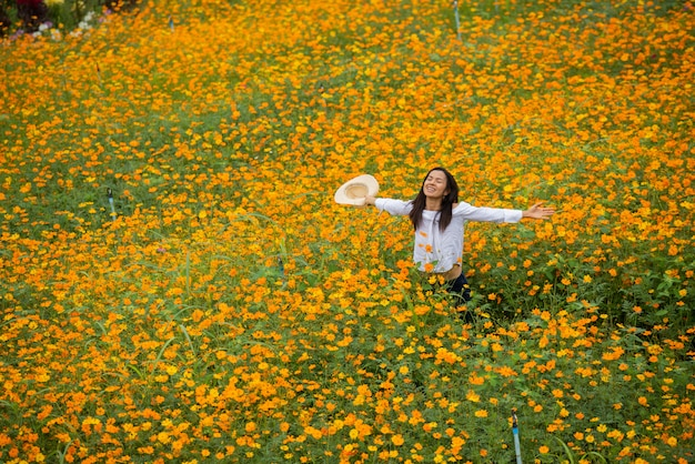 Asian women in yellow flower farm Free Photo