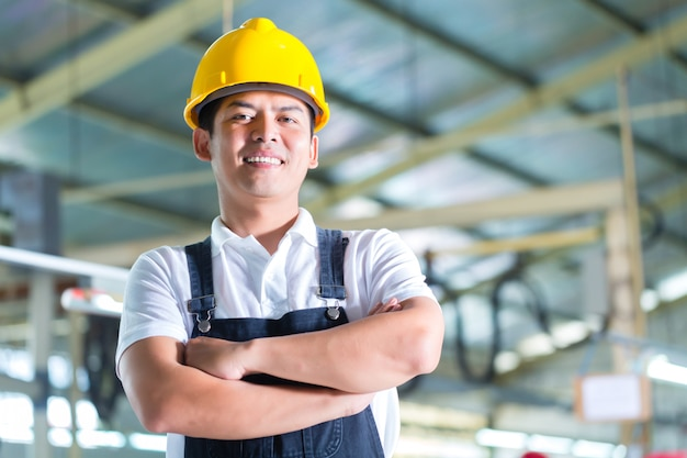 Asian worker in a factory or industrial plant Premium Photo