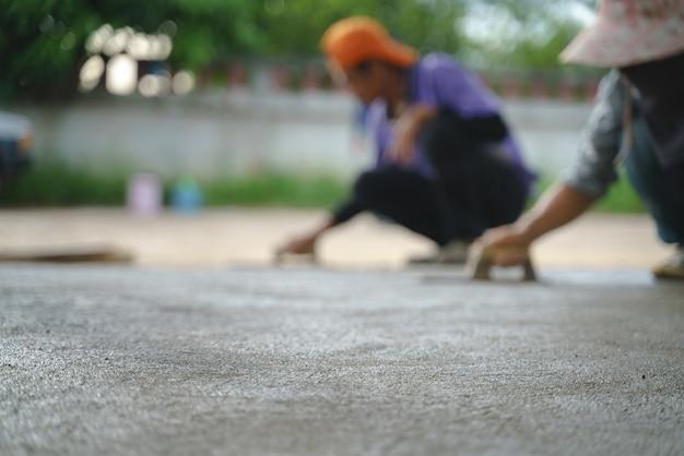 Asian worker labor working with concrete cement floor Premium Photo