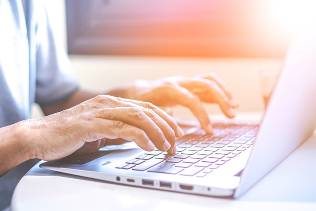 Asian young businesswoman working on her laptop. digital economy. Premium Photo
