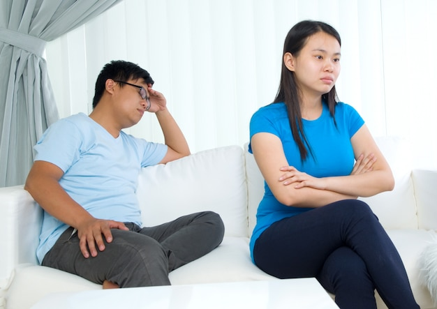 Asian young couple having argument in the living room Premium Photo