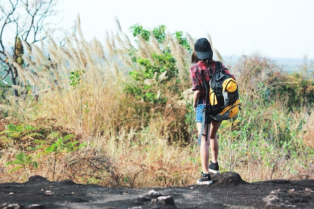 168664b72c Asian young girls with bright backpack enjoying in nature during ...