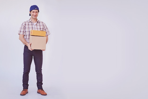 Asian young man holding box package, delivery man Premium Photo