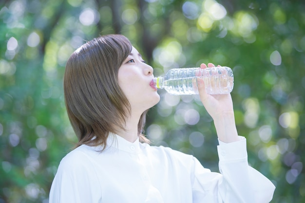 Asian young woman drinking water Premium Photo