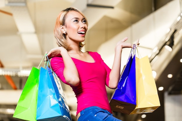 Asian young woman shopping fashion in store Premium Photo