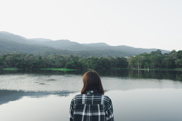 Asian young woman standing facing the sea. feeling really lonely, heartbroken Premium Photo