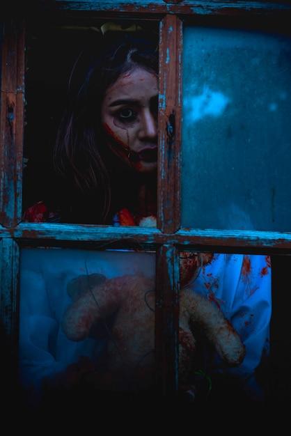 Asian young woman wear dress killer for halloween Premium Photo