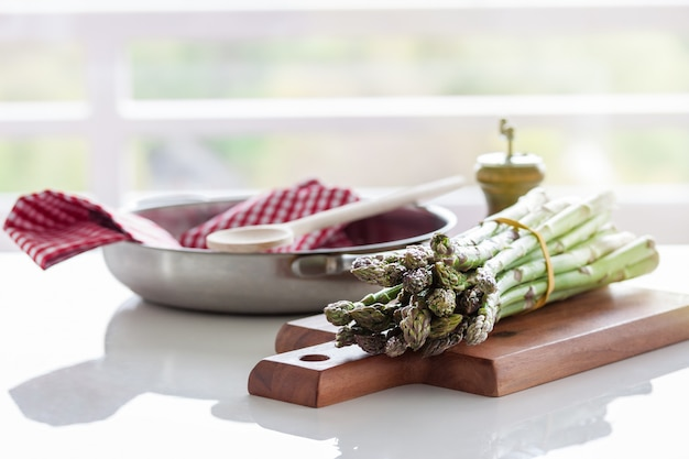 Asparagus on a wooden board near a cloth Free Photo