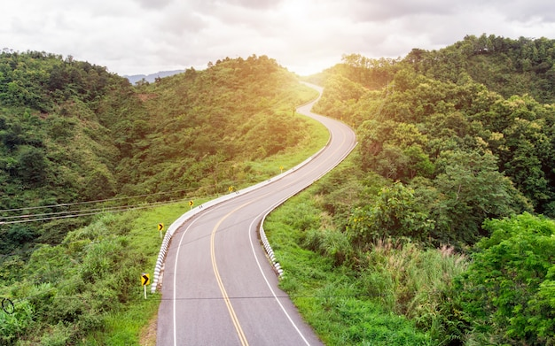Asphalt curved highway on mountain background Premium Photo