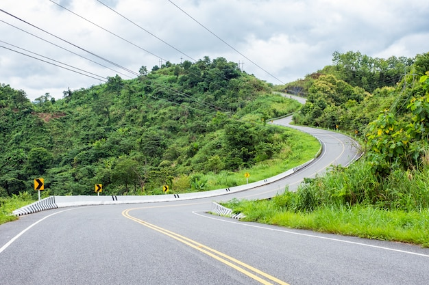 Asphalt road curved on hill Premium Photo