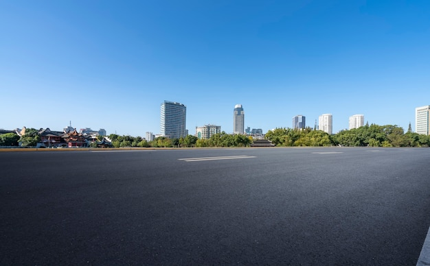 Asphalt road and modern architectural landscape skyline of chinese city Premium Photo