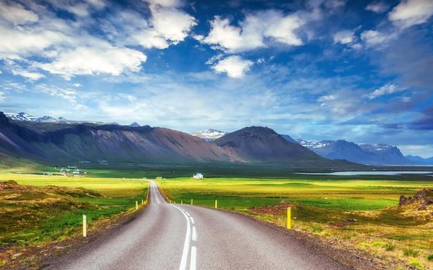 Asphalt road to the mountains iceland. Premium Photo