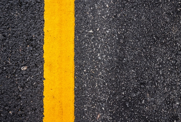 Asphalt road surface with yellow line Premium Photo
