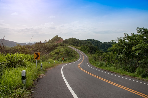 Asphalt road through with sign curves in the mountains. Premium Photo